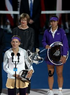Victoria Azarenka (L) of Belarus poses with the Daphne Akhurst Memorial Cup after winning her women's final match against Na Li of Chinaduring day thirteen of the 2013 Australian Open at Melbourne Park on January 26, 2013 in Melbourne, Australia.