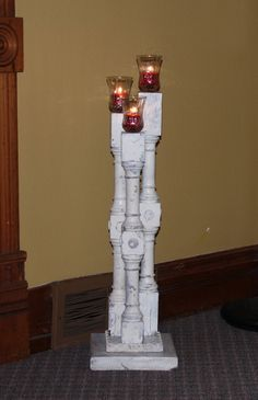 repurposed stair spindles to candle holders similar idea to the ones we are making for Ericas wedding.