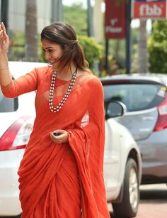 Tear drop Pearls with orange saree
