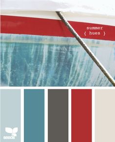 summer hues for the living room? redish couch, blueish accent wall, greyish walls, dark furniture