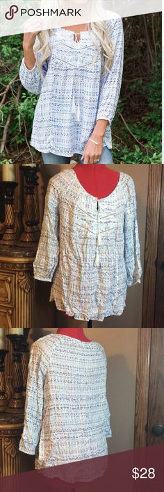 New!  White & Blue Tassel Peasant Top Light and airy comfortable top with tassel detail.  Looks a little wrinkled in pics from packaging. Beautiful drape. Very flattering! Tops