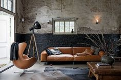 living room with brown leather furniture