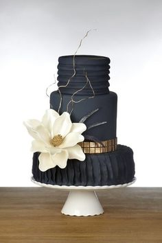 A matte black wedding cake. Would you? Black and gold wedding inspiration.