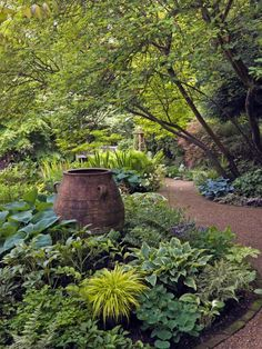 Front yard shade garden inspiration - add piece of art like a bench or bird bath to creates a focal point in a shade garden
