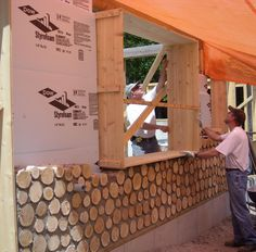 A double stack wall is a great idea for cold climates. When the wood shrinks, and it will, the foam, and or plywood, would help reduce drafts. Foam is best insulator, but man made product, that is toxic and highly flammable.