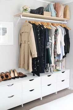 utilize your wall: what do you get when you combine a dresser and a super savvy shelf? something even more adorable than a closet. this owner's neutral wardrobe is even calming.