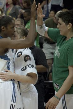 Minnesota Lynx Lindsay Whalen, Janelle McCarville, and Devereaux Peters celebrate after securing the victory 88-79. (Photo by Matthew Fleegel)