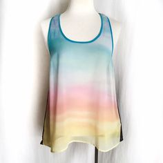 "Divided by H&M Sheer Pastel Racerback Tank✨HP✨ Sheer pastel multicolor tank with contrasting black back. Racerback style. 100% polyester. Machine wash. Size 4. Bust: 16"" flat across. Length: 24"" front, 27"" back. EUC. Thanks for looking! Divided Tops Tank Tops"