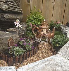 Fairy garden with teapot house