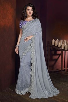 Light Grey silk saree with indigo blue banglori silk blouse, embellished with stone work and zari work. Saree with Sweetheart Neckline, Short Sleeve. It comes with unstitch blouse, it can be stitched 32 to 58 sizes. Grey Saree, Maroon Saree, Yellow Saree, Black Saree, Pink Saree, Satin Saree, Trendy Sarees, Indian Sarees Online, Latest Designer Sarees