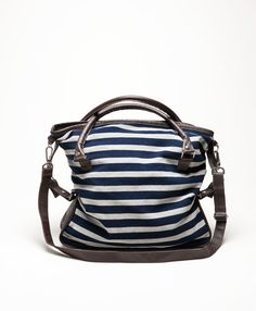 An update to our best-selling bag, this roomy piece features luxurious leather and classic navy and grey stripes. Whether you're toting your wallet and keys or want to fill this bag to the brim, it never fails to impress.