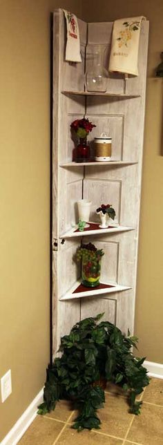 Love my corner door shelf - my dad cut an old panel door in half for me ..I painted , added hinges and used parts of another old door for the shelves...*love*