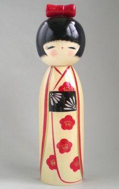 Cream, red and black Kokeshi
