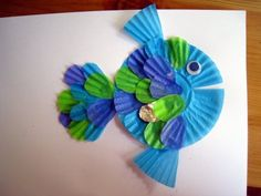 """Cupcake Liner Fish.  A great Storybok extension activity for the book """"The Rainbow Fish"""" by Marcus Pfister.  Could also use a small, colourful paper plate with a decorative edge along with the cupcakes liners for this activity!"""