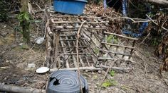 """A small cage is seen at an abandoned migrant camp used by people-smugglers in a jungle at Bukit Wang Burma in the Malaysian northern state of Perlis. Bangkok: The horror of Malaysia's jungle death camps has been revealed.  Photographs show make-shift bamboo prisons on stilts with mesh walls and coils of barbed wire Along a steep path strewn with clothes and food wrappings a low cage had been built, too small for a person to stand-up in.  """"These structures were believed to be used as human…"""