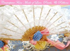 Lace fan centerpieces for a Marie Antoinette-inspired bridal shower