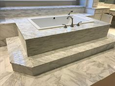Large Kohler underscore jetted tub mounted on a marble tub deck in Plano TX