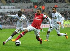The Ox stretches in the rain during #Swansea v #Arsenal