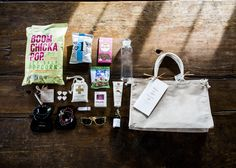 Who wouldn't want to fly out to a exclusive island, with pink sand and blue skies? To arrive with a personal gift bag full of custom jewelry, a bottle of the brides favorite perfume, custom shades, snacks, island and love inspired tunes, stereo, magazines, sunblock, maps, weekend itinerary, custom tote and more! I mean was this the best welcome bag ever or what?! #pulpandink