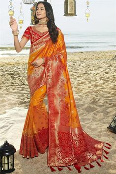 """Dark Orange Art Silk Wedding Saree,crafted with zari badla thread work enhancing the patterns on the saree together withtassels and motifs on the saree. Comeswith a matching blouse. This product will be as shown in unstitched material. For stitching to size select using our tailoring options """" customised """".Stitching to specific sizing is subject to design limitations. The blouse can be customised to fit sizes: 30,32,34,36,38,40,42,44 (uk sizes 6-18). Blouse length: 14-16. Slight… Diwali Fashion, Orange Art, Orange Blouse, Thread Work, Saree Wedding, Designer Wear, Designer Collection, Sari, Ad Art"""