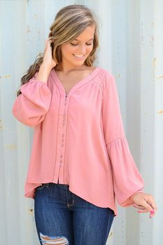 Flowy. Flirty. Fabulous. This gorgeous rose colored top by Black Swan is one you desperately need in your wardrobe. Here at Page 6, we know this beauty with its button down closure and flowy long slee