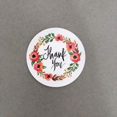 Set of 10 thank you stickers as pictured. 5cm Diameter Gloss finish White Background with floral wreath Wholesale pricing available on orders of 1000+ stickers Custom stickers available in quantities of 1000 only