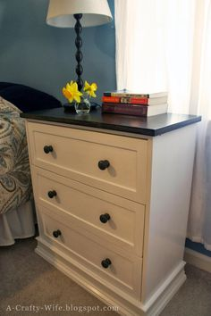 Ikea Rast Hack Part 1 - turning a $35 unfinished pine dresser into something nice with paint, stain, and a little trim work. From A Crafty Wife