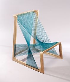 Environmental friendly seating furniture with silk thread tightened around a bearing oak frame. The transparent expression is in focus, which creates new forms and brings forth a perception of weightlessness, while the light produces new shadow plays from the thread works of the alvisilkchair.