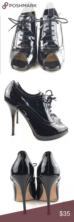 Vince Camuto peep toe stiletto oxfords Sz7 Vince Camuto peep toe stiletto oxfords, Sz 7, Women's,  Black high heel patent shoes, patent leather, club wear, hight 3 in to 4.5 in, Oxfords style, laced up, good condition, ready to ship. Vince Camuto Shoes Heels