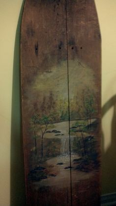 painted on antique ironing board. tried to make the scene look old....