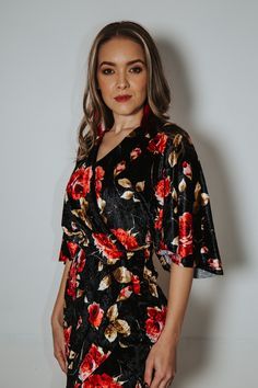 Inspired by the Kimono this cocktail dress boasts a drape sleeve and clever tuck detail at the bust line. The more form-fitting bottom hugs the hips with its tulip silhouette. Cocktail Wear, Tulip Dress, Hugs, Tulips, Floral Tops, Clever, Kimono, Silhouette, Inspired