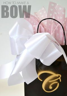 How to tie a large bow and an idea to spray paint an initial on the gift bag to personalize it for the recipient