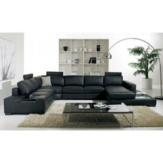 The T35, an ultra modern sectional sofa made entirely of beautiful black leather is a fashionable and functional piece of contemporary living room furniture. Black glass top and stainless steel leg coffee table not available, rather the T35 Wenge Coffee table is the perfect addition to this sectional sofa- included in the gallery.