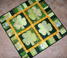 Raw edge applique wall hanging for St. Patrick's Day. Shamrocks Quilt Pattern QBE-105e by Quilts by Elena - Elena McDowell.  Check out our wall hanging patterns. https://www.pinterest.com/quiltwomancom/quilted-wall-hangings/  Subscribe to our mailing list for updates on new patterns and sales! https://visitor.constantcontact.com/manage/optin?v=001nInsvTYVCuDEFMt6NnF5AZm5OdNtzij2ua4k-qgFIzX6B22GyGeBWSrTG2Of_W0RDlB-QaVpNqTrhbz9y39jbLrD2dlEPkoHf_P3E6E5nBNVQNAEUs-xVA%3D%3D: