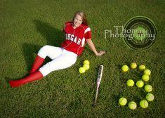 Picture idea. Softball in this case but you can any sports' ball.  The softballs to be the number of the jersey.