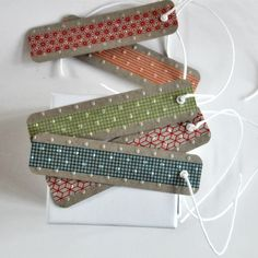 gift tag inspiration... that gauzy white fabric with white spots over top regular fabric nice idea