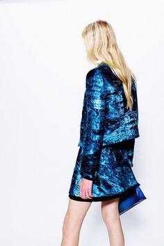 mermaid blue glitter ensemble . Blazer and mini skirt, with an electric blue clutch