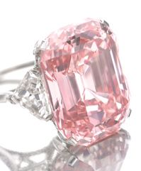 The Graff Pink. The most expensive diamond ever sold, to date. 24.78ct fancy intense pink, IF (internally flawless), emerald cut diamond in platinum setting with special cut triangular side diamonds.