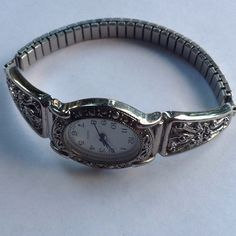 Vintage Watch Price Firm Silver tone really nice watch. I have had this watch over 25 years never wore it. I'm sure it needs a battery. New! quartz Accessories Watches