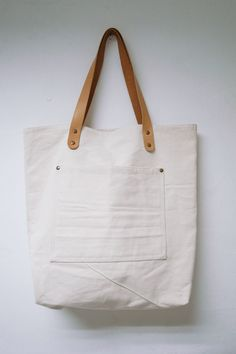Leathinity - Beige Canvas Tote Bag w/ Genuine Leather Handles - Eco Friendly. $64.99, via Etsy.