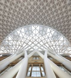 Beautiful soaring ceiling in the modern portion of the historic King's Cross Station in London, England