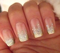 Dazzling french style nails with a hint of silver glitter and gold tips. Very gorgeous for prom