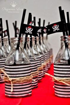 Love the idea of wrapping bottles like this to match a pirate birthday party theme.