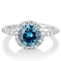 Silvertone March Imitation Birthstone Ring - Light Blue CZ. Celebrate life with a Sterling Silver Imitation Birthstone Ring!. Imitation Birthstone rings are the perfect way to gift someone something special on their birthday. This March aqua CZ ring features a 2 carat round cut stone that is surrounded by petite size clear stones giving off the angelic halo effect. Smaller size CZs extend partially down each side of the band for even more radiance. Sparkle in style during your birth month…