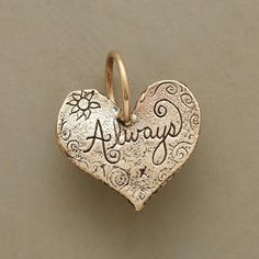 """GOLD ALWAYS HEART CHARM--Jes MaHarry's heart charm engraved with up to five initials. Stamped heart on reverse. 14kt gold. 1""""L.For Mother's Day delivery order must be placed by May 4th, midnight MST    (expedited charges may apply.)"""