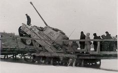 This Panther V command tank has a real problem over a wide frozen lake after being a victim of this collapsed bridge.
