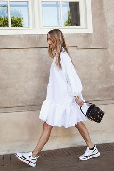 Dress and trainers outfits: Pernille Teisbaek wearing prairie dress with Chloe trainers. White oversized dress with sneakers. Mode Outfits, Casual Outfits, Classy Chic Outfits, Coach Outfits, Dress And Sneakers Outfit, White Dress Outfit, Dress Outfits, Plain White Dress, Sneaker Outfits Women