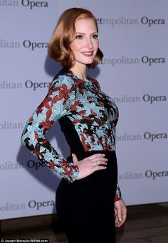 Elegant: The Zero Dark Thirty actress chose a clingy peekaboo multi-coloured top, which showed off her trim figure and impressive assets, for the Metropolitan Opera's season opening night of Verdi's Otello