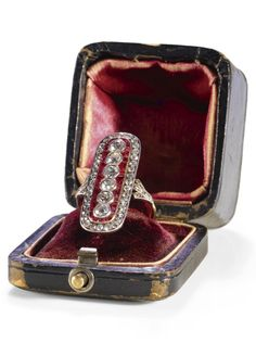 Alexander Tillander - An antique diamond and ruby ring, St Petersburg, 1908-1917. Designed as a plaque, set with a central row of collet-set circular-cut diamonds, within borders of calibré-cut rubies and circular-cut diamonds, 56 standard. #antique #ring #Tillander
