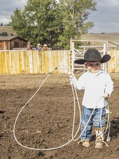 Tiny cowboy Bronc practices his roping during a rodeo at The Ranch at Rock Creek in Montana. | The World's Only Forbes Travel Guide Five-Star Ranch